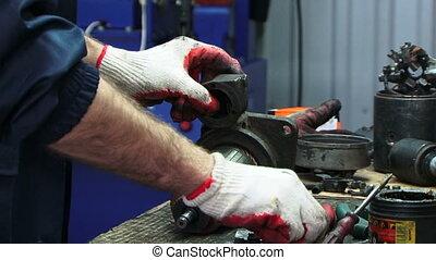 Electric generator - Mechanic repairing electric generator