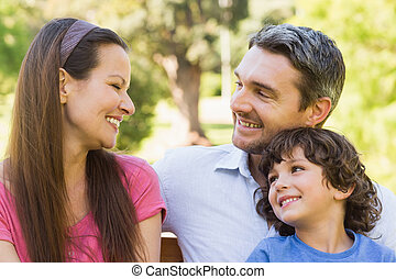 Smiling couple with son in park