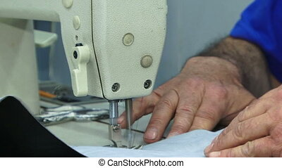 Sewing lining of a car - Machinist sewing lining of a car...
