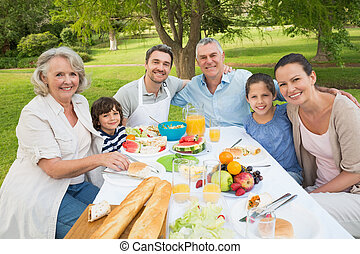Extended family dining at outdoor table - Portrait of...