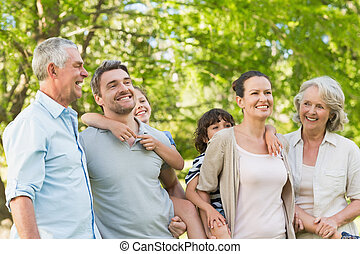 Portrait of cheerful extended family in park