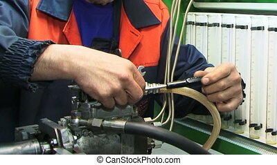 Mechanic at work - Mechanic checking the engine