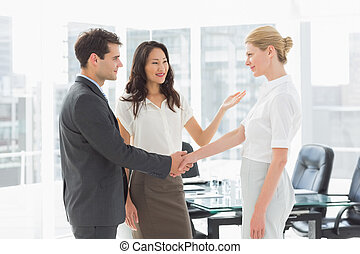 Businesswoman introducing colleagues in the office