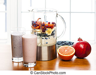 Making smoothies in blender with fruit and yogurt