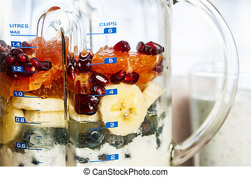 Blender with fruit and yogurt for smoothies - Closeup of...