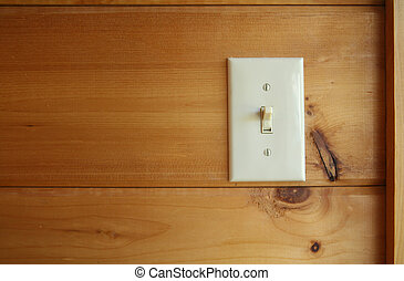 lightswitch - Light white switch on wooden wall