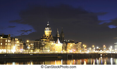 Amsterdam by night - The beautifully lit monumental...