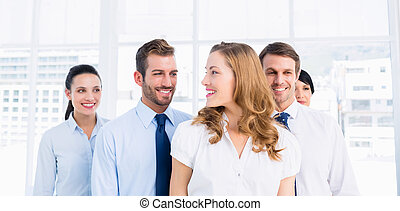 Confident and happy business team together in office -...