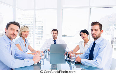 Executives sitting around conference table - Smartly dressed...