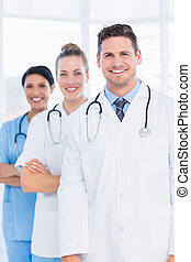 Confident happy group of doctors at medical office -...