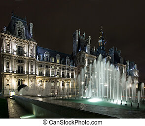 Hotel de Ville Paris - The lit fountains in front of the...