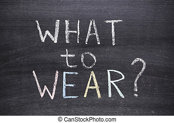 what to wear question handwritten on school blackboard