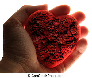 Red stone heart in male hand