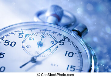Stopwatch on snow in blue toning