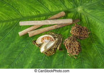 Tobacco leaves were dried, cut into small strips called line...