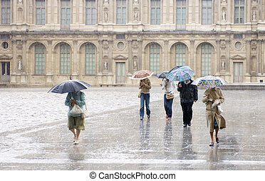 Heavy Rain at the Louvre - Pedestrians, rushing for cover at...