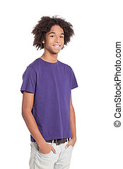 Cheerful teenager. Smiling African young teenage boy holding hands in pockets while standing isolated on white
