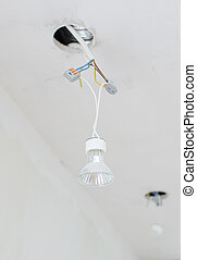 Undone halogen light bulbs on electric wires.