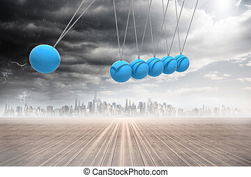 Newtons cradle above city