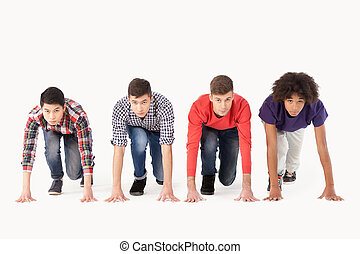 People on starting line Group of young multi-ethnic men...