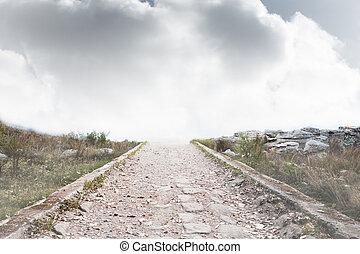 Stony path leading to misty horizon