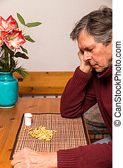 portrait of a man with medications - portrait of a elderly...