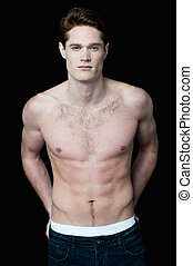 Young handsome shirtless male model - Fashion portrait of a...