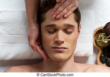 Young man getting spa treatment