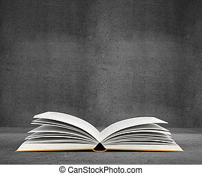 open book on concrete background