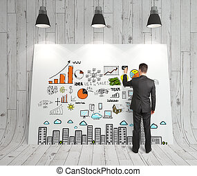 business strategy - businessman drawing business strategy on...