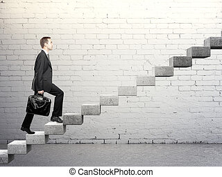 staircase - Businessman stepping up a career stair