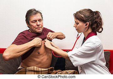 doctor is checking heartbeat - doctor and patient checking...
