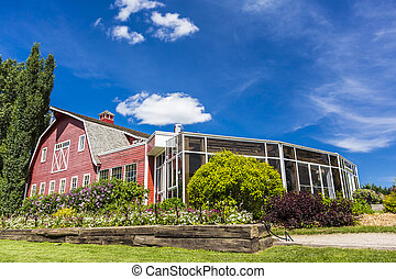 Sunroom on Barn - A sunroom attached to a red barn with many...