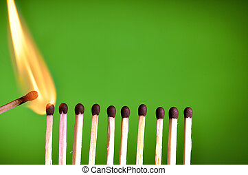 burning matches - concept with matches- chain reaction