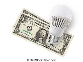 spending money - LED bulb over dollar bills isolated on...