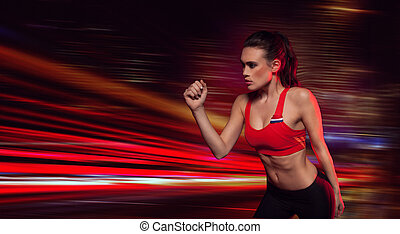 Strong determined female athlete in sportswear with her arm...
