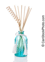 Blue air freshener bottle with scented sticks, isolated on white