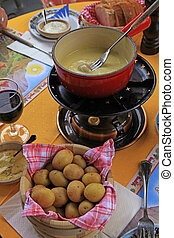 typical Swiss cheese fondue - Fondue is a Swiss and French...