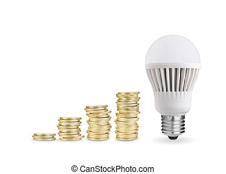 coins and LED bulb - Money saved with LED bulb Isolated on...