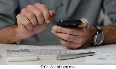 Businessman working with smartphone - Mobile phone at the...