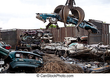 Grabbing car - Crushed cars being picked up by a grabber