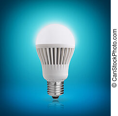 LED bulb - Glowing LED bulb on blue background