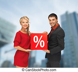 smiling man and woman with percent sign - shopping and sale...