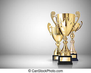 trophies - golden trophies on gray background