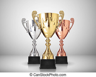 trophies - golden,silver and bronze trophies on gray...