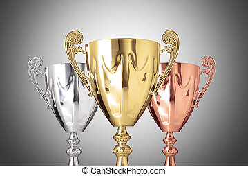 trophies - Close up golden,silver and bronze trophies on...