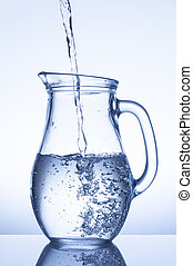 jug - Flowing water in a jug on blue background