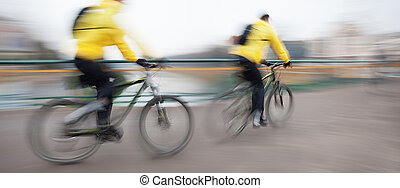 cyclists on the city roadway - Abstract image of two...