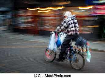 Old man riding a bicycle - Old man with a large number of...
