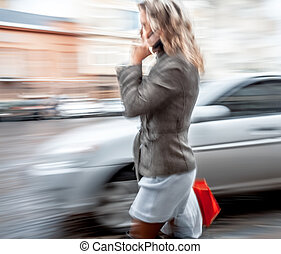 young woman talking on a mobile phone - Abstract image of a...